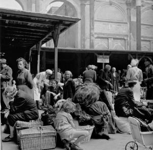 German refugees with what is left of their belongings on the Tiergarten station in Berlin (August 1945)